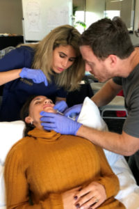 Dr Nora Sadek teaching lip filler